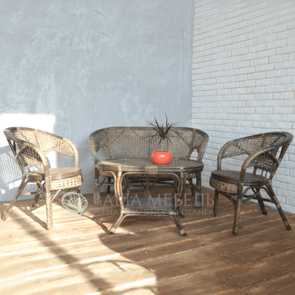 Set of Pelangs Family with an oval table made of natural rattan.